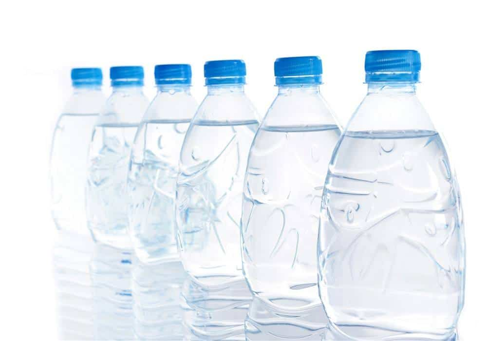 Use bottle water to save your hair from hard water