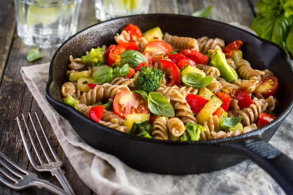 Pasta and vegetables cooked in an iron pan