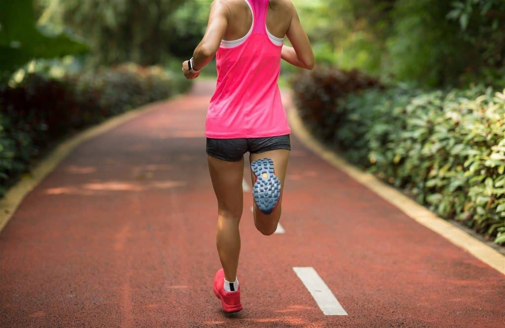Woman Running: Iron is important for energy and stamina